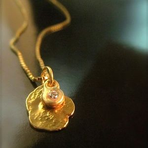 14k yellow gold necklace with gold coin & Diamond.
